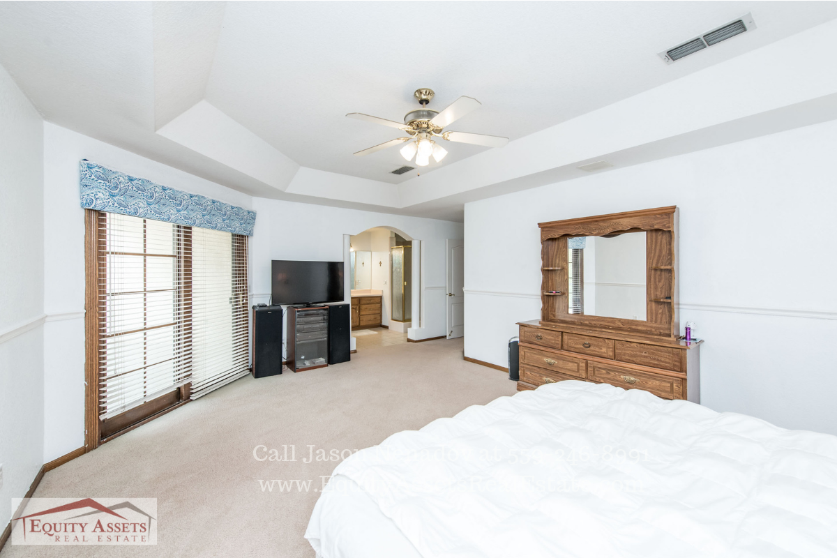 Real Estate Properties for Sale in Kingsburg CA - Enjoy the best retreat and relaxation in the comfortable master bedroom of this pool home in Kingsburg CA.